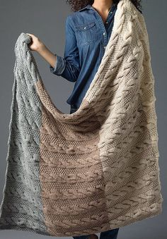Free Knitting Pattern for Four Color Cable Afghan - This blanket features a cable pattern and moss stitch in four color sections.