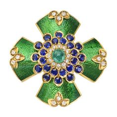 "Estate David Webb Gem-Set & Enamel Cruciform Brooch Gem-set and green enamel cruciform brooch, centering on a cabochon-cut emerald, accented by circular-cut sapphires and diamonds, mounted in yellow gold, signed ""Webb"" for David Webb. David Webb, Jacqueline Kennedy Onassis, Enamel Jewelry, Fine Jewelry, Silver Jewellery, Jewelry Art, Silver Rings, Fashion Jewelry, Beach Jewelry"