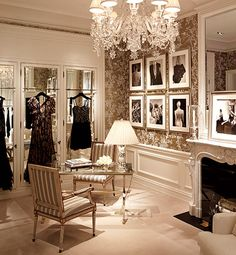 My next closet will look like this. The vibe is perfectly luxe lady for me and I'm loving components of this space - the fireplace, additional mirrors and idea of a place for art and a focal piece of lighting.