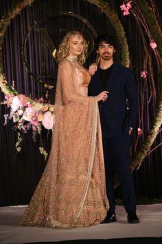 39a46c9afe Joe Jonas Sophie Turner in a gold Sabyasachi lehenga for Priyanka Chopra  Nick Jonas reception party.
