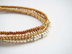 #tiny #beaded #bracelet #friendship #gold #bronze #silver by juditpukkai  Use coupon code on Etsy: PIN10 to get 10% discount :-) Beaded Jewelry, Handmade Jewelry, Beaded Bracelets, Unique Jewelry, Handmade Gifts, Pj, Coupon Codes, Friendship Bracelets, Bangles