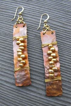 Idea: hammered copper shapes with lacing and contrasting metal shapes repeated
