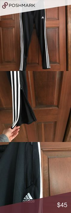 Adidas track pants Adidas track pants with side zip.  Slightly tapered.  Wore a couple times.  No signs of wear. Adidas Pants Track Pants & Joggers
