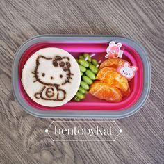 Day 53 snack: organic orange chocolate Hello Kitty sandwich, edamame, orange