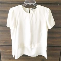 ZARA WOMAN White Blouse Top SMALL Size Small, looks like it has two layers, the bottom layer is sheer. Goes well with high waist pants or skirts. Good quality fabric. Can wear at work, during the day or at night with a nice necklace and nice pants.  Zara Tops Blouses