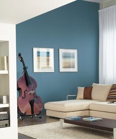 This contemporary space is warmed up by PPG Pittsburgh Paints' Montana Collection. The stunning blue on these walls (Prussian Blue 551-6) adds depth to the space, and sets off the earth-tone accesories and furnishings.