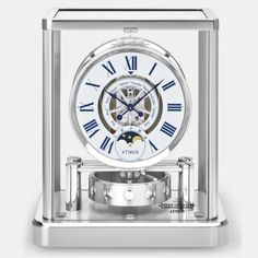 Style and elegance are the hallmarks of this Atmos Classique Phases de Lune clock in its rhodium-plated cabinet. Gaze dreamily at the movements of the moon in the heart of this beautiful and timeless object. Expensive Watches, Plating, Interior Decorating, Art Deco, Boutique, Clocks, Moon, Lunar Phase, Brass