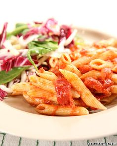 """In this method adapted from Giuilano Bugialli's """"Classic Techniques of Italian Cooking,"""" dry pasta such as penne or rigatoni bakes with fresh or canned tomatoes. The result: Deeply flavorful, tender, authentic Italian pasta destined to become a favorite."""