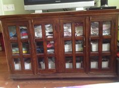 Short glass-front shelves; Dimensions: 70 in wide, 16 in deep, 43 in tall