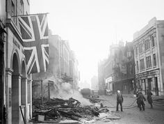 Taylor (Mr) -- A Union Flag hangs defiantly from a building in the aftermath of the air raid which devastated the centre of Coventry on the night of 14/15 November 1940. -- High quality art prints, canvases -- Imperial War Museum Prints