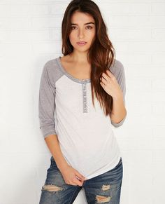 <p>You're going to need more than one of these henleys in your closet this season! The tee features a soft, burnout knit body, contrast raglan sleeves, and a snug fit.</p> <p>Model wears a size small.</p> <ul> <li>Scoop Neckline</li> <li>Button Front Placket</li> <li>3/4-Length Sleeves</li> <li>Unlined</li> <li>Cotton / Polyester</li> <li>Machine Wash</li> <li>Imported</li> </ul>