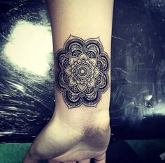 Mandala tattoo designs fall into the category of spiritual tattoos as they have deeper spiritual meaning, which make them very different from the rest - Part 2 Mandala Wrist Tattoo, Mandala Tattoo Meaning, Wrist Tattoo Cover Up, Flower Wrist Tattoos, Mandala Tattoo Design, Feather Tattoos, Cover Up Tattoos, Flower Tattoo Designs, Foot Tattoos