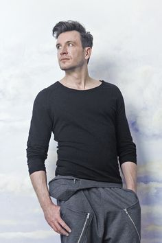 JUST WEAR IT The best cut for a male body. A raglan top with craftily sewed in sleeves can do more than a classic T-shirt – it'll make your shoulders broader so looking at your back could be very distracting...