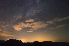 Photographer Jeff Dai captured this view of a Perseid meteor shower fireball streaks above the city lights of Nanchuan in western China on Aug. 11, 2013. Dai took the photo from Mount Jinfo, Chongqing, China.