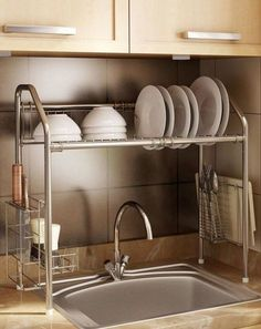 Flexible Steek Sink Storage Shelf: This vertical drying rack stores dishes on top and cutlery and utensils on the sides. Plus, you won't drip water when transferring items since it's positioned directly over the sink. Click through for more kitchen sink supplies you'll love.