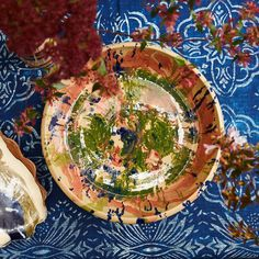 Color explosion! Our new range of Pollock Bowls and the blue and white Siena tablecloth. All available through the link in bio #casacabana #handmade #tablesetting #livewithcolors #pottery #globalcraft #handpainted #cabanamood