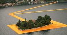 """The experience of a lifetime will soon be available to Italy's public. Thanks to artists Christo and Jeanne-Claude, a floating walkway now exists on Lake Iseo in northern Italy. The installation - """"The Floating Piers"""" - Land Art, Christo Floating Piers, Christo Y Jeanne Claude, Landscape Art, Landscape Architecture, Landscape Design, Italian Lakes, Environmental Art, Art Plastique"""