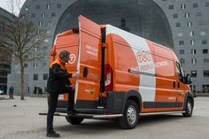 TNT parcel delivery vehicle and employee