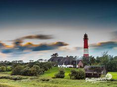 Wolken ziehen am Pellwormer Leuchtturm vorbei
