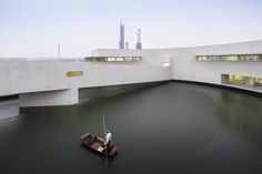 "Built by Álvaro Siza,Carlos Castanheira in Huai'an, China with date 2014. Images by Fernando Guerra | FG + SG. The inauguration of ""The Building On the Water"" of the Shihlien Chemical plant in Huai'An City, Jiangsu Province, wil..."