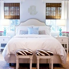 blue & white bedroom with brown accents. Love the zebra print stools.