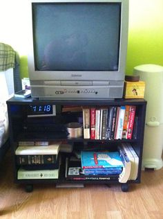 how to baby proof a low bookshelf or tv stand - Child Proof Bookshelves