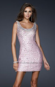 Get your sparkle on at Prom with this amazing Sequined mini! It's available in tons of colors so you're sure to find one that you fall in love with! The scoop neck design is perfect to narrow the shoulders! The neckline features lines of shining rhinestones to add sparkle to your look! The La Femme 17413 is covered in sequins and rhinestones so your glam effect is pumped way up! Don't forget sparkling shoes to complete your glitzy look!