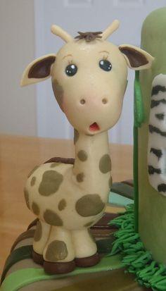 Gumpaste baby giraffe, via Flickr.