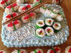 I searched for ideas and then created my own version of a sushi cake using cake, candy, fruit roll-ups, rice krispies, marshmallows, chocola...