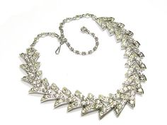 "Jewel incrusted necklace by Sarah Coventry named ""Parisienne Nights"" from c 1961 and loaded with pave set rhinestones. The necklace 17 is in"