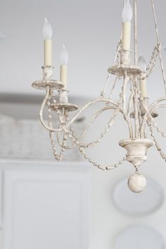 I think every room should have a chandelier and a fireplace....oh a girl can dream!