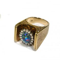 Opal and Diamond Ring. The Australian fire opal ring with diamond surrounding was given to Ginger Alden (Elvis' girlfriend and fiancee) in 1976.