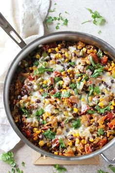 An easy, one pan recipe for skillet mexican brown rice casserole. With plenty of veggies, black beans and spices!