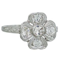 Art Deco Diamond & Platinum Four Leaf Clover Ring 1.05ctw | From a unique collection of vintage fashion rings at https://www.1stdibs.com/jewelry/rings/fashion-rings/