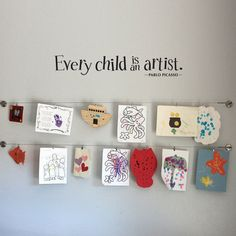 Display kids artwork with curtain wire from Ikea!