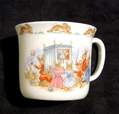 This is a cute cup, that shows bunnies at a puppet show. It's English fine bone china made by Royal Doulton. $19.99 on ebay.