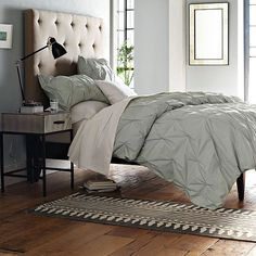 pintuck duvet from west elm (have it) pinboard headboard (want it) Love the rug too.