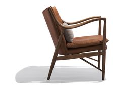Relax in the Oslen. A true Danish beauty! The Olsen chair features full grain saddle leather over a maple frame. The Olsen chair displays classic lines of mid century Modern Norwegan furniture. Ships with pictured beige linen lumbar pillow.