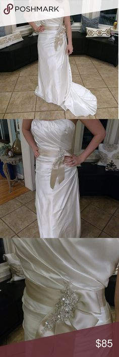 """NWOT DAVID'S BRIDAL WEDDING GOWN or PROM DRESS NWOT Wedding Gown or Prom Dress. Sweetheart neckline. Ivory with champagne sash and jewel details. Worn for a styled shoot - indoors for 45 min. Has bustle! I'm 5'6"""" and it hits the floor in flats. Small stain on back of train (I'd try dry cleaning it) David's Bridal Dresses Wedding"""