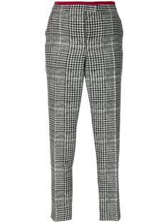 Shop Fendi dogtooth tapered trousers.