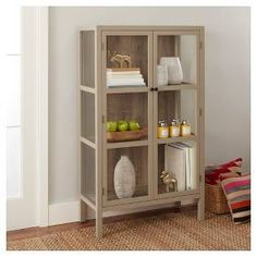 The Vista Library Cabinet with Glass - Threshold combines the elegance of glass with a rustic wood look — the perfect furniture for displaying precious antiques and collectibles. Its simple design blends easily with any décor from traditional to mid-century modern to contemporary.