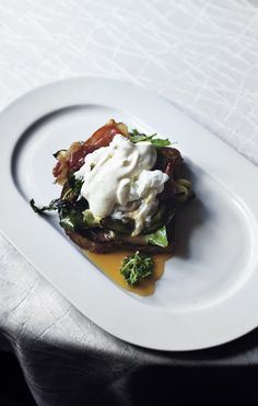 Toast with grilled zucchini, prosciutto, poached egg and lemony creme fraiche.