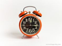 A cheery orange clock makes waking up early (almost) fun.