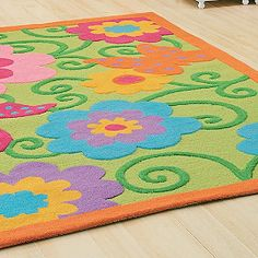 Super bright rug...has the wall color and the pink, blue, purple of the toys in the playroom