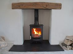 Heat proof skamolex boarded chamber with reclaimed clad oak beam, slate tiled hearth and Charnwood C4 wood stove. fitted in South Fambridge Essex 2012