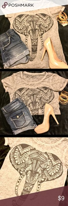 Tribal Elephant Graphic T-Shirt by Well Worn Tribal elephant graphic t-shirt by Well Worn. Size XS. Gray with black elephant. Loose fitting.  EUC. I'm new so I'm accepting any reasonable offers ❤️ Bundle with any other items and I'll discount Tops Tees - Short Sleeve