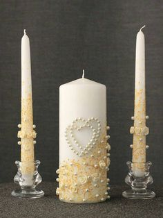 Wedding Unity Candles Set.  Each candle is hand-painted with cold wax and hand decorated.  This Wedding Unity Candle Set comes with the following:  > 1 Center white pillar candle H 7.8 inches (20 cm) x W 2.73 inches (7 cm) > 2 Side white taper candles H 9.75 inches (25 cm)  Info:  >Set does not include candle holders. >Bride and groom names and date can be painted on candles. >Made for order. >Materials: Wax candles, cold wax colours for painting , fabrics.   PLEASE READ CAR...