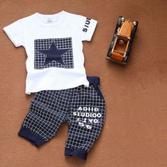 Funky suit. kachestvo super. zakazala 18-24 months, the son of 9 months at the time but it big. prodavtsu thanks for podarochek. very nice!! Baby boy clothes 2016 Brand summer kids clothes sets t-shirt+pants suit clothing set Star Printed Clothes newborn sport suits