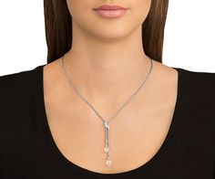 A classy creation, this rhodium-plated Y-shaped necklace has two briolette-cut clear crystals. These are set on a snake chain and clamped together... Shop now