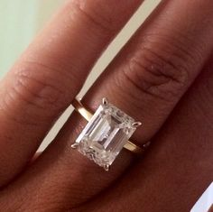 4ct diamond, emerald cut, yellow gold thin band.